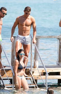 Ripped: Cristiano Ronaldo, 31, may be relaxing after a gruelling season with Real Madrid but he certainly looked in impressive shape as he took to the water on the Spanish island on Friday