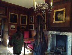 Two Young Girls visited Hampton Court and got what seems to be the grey lady on one of their photos.