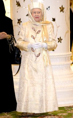 2010 from Queen Elizabeth II's Royal Style Through the Years: 2010 The Queen visited The Sheikh Zayed Mosque in Abu Dhabi wearing a cream-colored brocade dress and matching head covering. UK Press\UK Press via Getty Images Princess Elizabeth, Queen Elizabeth Ii, Royal Family Pictures, Queen Margrethe Ii, Elisabeth Ii, Brocade Dresses, Her Majesty The Queen, Queen Mother, Save The Queen