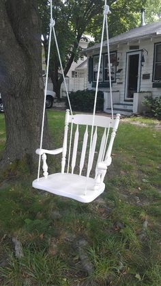 Recycled chair made into a swing.