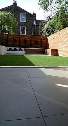 Hardwood Privacy Screen Trellis Slatted Batten Fence With Artificial Grass in Modern Low Maintenance Garden London