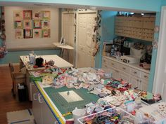 As opposed to a neat and EXTREMELY tidy craft room.....here's one with the 'lived in' effect, and working very well by the looks of it!