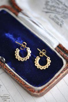 stylized gold earrings