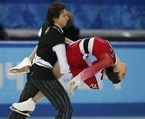 Cathy Reed and Chris Reed of Japan compete during the figure skating team ice dance free dance at the Sochi 2014 Winter Olympics, February 9, 2014. REUTERS/Alexander Demianchuk