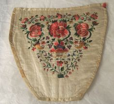 Cream silk, boned and mounted on stiff canvas, spade-shaped. Embroidered in coloured silks in split stitch in floral design. 1730-1750