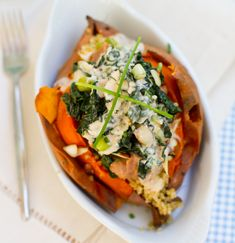 This vegan stuffed sweet potato is hearty but healthy, loaded with kale, shiitake mushroom quinoa, refried beans, chives, and chipotle sauce.