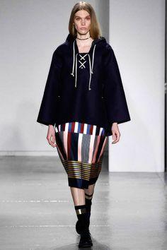 Suno Fall 2014 RTW. #Suno #Fall2014 #NYFW rich jewel blue. poncho like sweater. color block patched skirt. bohemian.