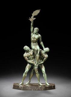 Pierre Le Faguays - 'Tropheé' a green patinated bronze figural Group, circa 1925.