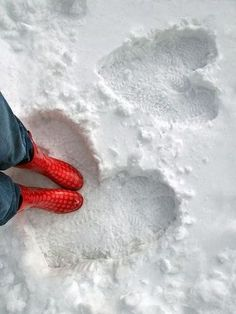 These red boots are a perfect match with the beautiful snow heart.