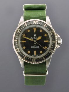 Vintage military submariner....probably goes for about USD100K if the numbers match!
