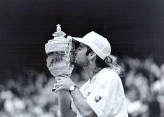 Andre Agassi kisses his first Grand Slam Trophy, Wimbledon 1992.  #tennis