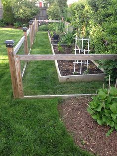 Homemade garden fence with raised beds