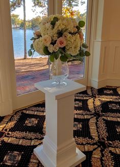 """33"""" tall, white wooden painted pedestals.  2 available for rental for weddings and events in Charlotte, NC."""