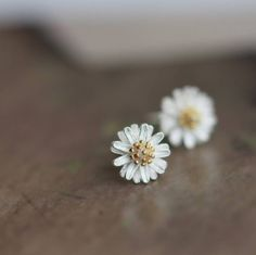 Silver Daisy Ear Studs from notonthehighstreet.com  Please, please, please