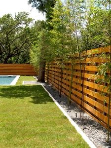 The Fence Serves As A Nice Backdrop For This Modern Backyard. Reminiscent  Of Japanese Woodwork