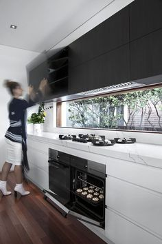 Luxury Kitchens A Designer's Life Bayview Ave Project using Black Wenge Ravine. - A pure black timber grain with slightly evident warm timber undertones, grain more evident in CREATEC gloss. Appears pure black with straight grain in RAVINE. Black Kitchens, Luxury Kitchens, Home Kitchens, Modern Kitchens, Modern Kitchen Design, Interior Design Kitchen, Küchen Design, Layout Design, Minimalist Kitchen