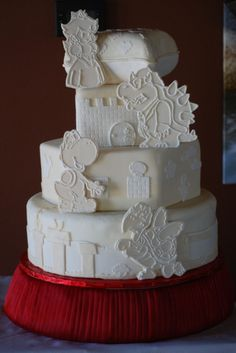 Have the characters piped more like lace cutouts and hidden in the flowers cascading down the cake.