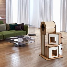 The Vesper V Tower Cat Scratch Tree Furniture is a beautifully deisgned cat tree featuring places to scratch climb and hide.