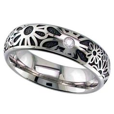 Dome profile Titanium ring with repeating flower pattern by GETi