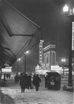 Chicagoans enjoy a wintry night on State Street in 1942 by the Chicago Theatre, just south of Randolph Street. Looking for more holiday magic? Join us for ChicaGlow To purchase a copy E-mail...