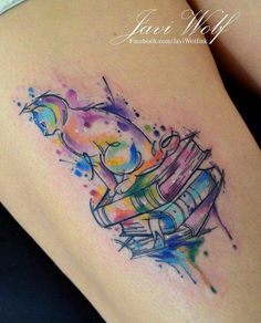 Javi Wolf watercolor cat and books tattoo