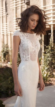 This collection embodies those feelings of femininity and power, through the bohemian glamour style, features romantic wedding dresses in relaxed silhouettes and two-piece ensembles puffy short sleeves Wedding Dresses 2018, Bohemian Wedding Dresses, Bridal Dresses, Relaxed Wedding Dress, V Neck Fit And Flare Wedding Dress, Wedding Dresses Simple Short, Short Hair Wedding Styles, Wedding Hair For Short Hair, Fitted Wedding Dresses