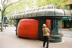 Red Ball Project - a massive vinyl ball wedged into in between buildings, bus stops, alleys in various cities. This traveling public art installation by Kurt Perschke, has been engaging people across cities around the world since 2006.