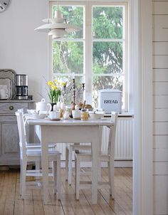 I like the whiteness of this kitchen