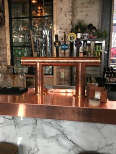 Two of our copper brass draft towers showing at The Rose Pub in UK www.tappedbeer.cocm #tappedbeer Copper Draft Beer Tower Pub Bar England