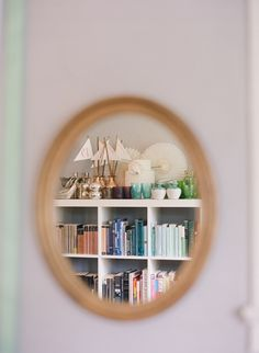 Colored glass collection above bookshelf.  Just a neat detail shot - Kelly Oshiro Design.