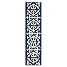 """Hand-hooked wool rug in navy blue with a medallion damask motif.   Product: RugConstruction Material: 100% WoolColor: Navy blueFeatures: Hand-hookedDimensions: 2'6"""" x 10'Note: Please be aware that actual colors may vary from those shown on your screen. Accent rugs may also not show the entire pattern that the corresponding area rugs have."""