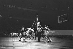 UCLA Willie Naulls (33) in action, tipoff vs Duquesne at Madison Square Garden. Hy Peskin X3397 TK1 R7 F14 )