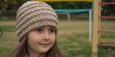 Easy beanie knitting pattern. Free. A beautiful, practical hand-knitted hat. It will suit a little girl or older girls. A model is stylish and pretty, it is good both for autumn and winter. The hat is very easy to make, it will be knitted just in a few ho