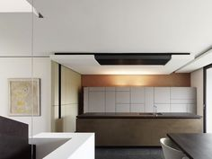 """""""An abstract crazy quilt of cupboards in the kitchen is well disguised as a sculptural piece."""""""