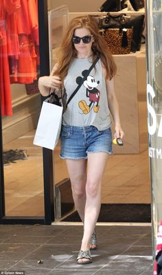 Her playful side: Isla Fisher looked as youthful as ever as she browsed the trendy shops along Hampstead High Street in London on Thursday