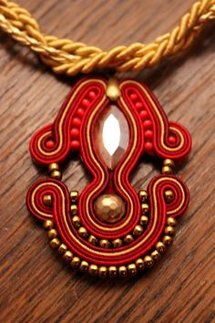Soutache neckles with pearl-color cabochon and gold beads