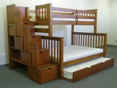 Bunk Beds - Top twin, bottom full, trundle twin. 4 drawers in stairway, plus 2 shelves