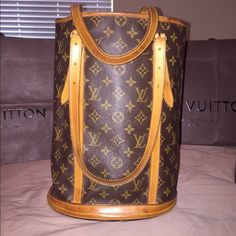 Host Pick % Authentic LV large bucket purse FREE Posh concierge authentication and shipping! Large Pre-loved Louis Vuitton bucket purse. Authenticity GUARANTEED!!! Purchased at the LV store in Roosevelt Field Mall in Garden City, NY. The bag shows a deep caramel patina on the leather all around. There are pen marks in the interior. Absolutely NO peeling, sticking, scratches or cracks anywhere. There are some water stains on the bottom exterior leather band. Date code: FL0031 Thx for looking…