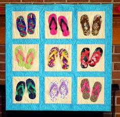 My awesome flip flop quilt with details describing parts of my life (Captain, dolphins, watermelons, Devon, etc.)