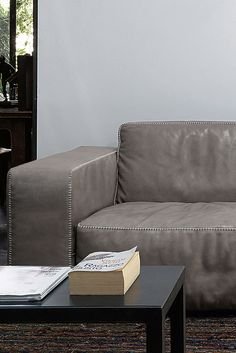 Oxer sofa is made with high-resilient foam seat cushions, topped with feather down for maximum comfort. Available in leather or fabric upholstery.