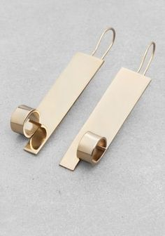 Elegant, shiny earrings made from gilded brass.