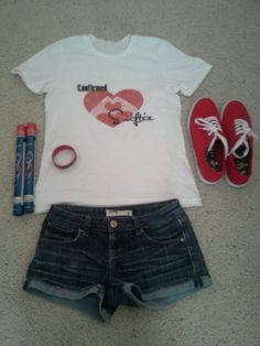 Here's what I'm wearing to the Taylor Swift Red Tour with @Kaley Lillypad Shirt=custom made(: shoes=target shorts=tillys bracelet=walgreens glowsticks=target