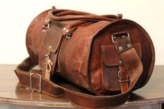 Vintage handmade overnight round Duffel bag  Leather used for these bags is still processed in the traditional ways that have been around for generations. It is not processed by use of chemicals or dyes but by traditional methods of sun tanning and hand done vegetable oil polish. The leather also gets softer with age and develops a unique texture and finish.  24 x 10 x 10 inches  Features:  Zipper compartment 1 front pocket and 2 sides pockets Adjustable shoulder strap  Inside canvas lining