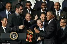 Love towers over the president, who is six-foot-one, during the ceremony on Thursday Read more: http://www.dailymail.co.uk/sport/othersports/article-3926678/LeBron-James-Cleveland-Cavaliers-Mannequin-Challenge-Michelle-Obama.html#ixzz4Pol5Q8o5 Follow us: @MailOnline on Twitter | DailyMail on Facebook