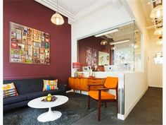 Nice  combination of colorful furniture and maroon wall  - Charming  Office Space