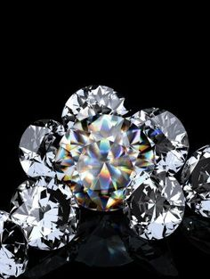 Google Image Result for http://us.123rf.com/400wm/400/400/apttone/apttone1105/apttone110500001/9483225-group-of-diamonds-on-black-background-beautiful-sparkling-diamond-on-a-light-reflective-surface-high.jpg