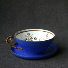 blue enamel cup with folk art motif on it from Mademoiselle Chipotte on Etsy