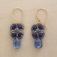 "BURST OF BLUE EARRINGS -- Bursting from a Swarovski crystal center, blue quartz and Miyuki bead petals bloom above a kyanite briolette. Handmade in USA by Miguel Ases. 14kt goldfill wire. 1-3/8""L."