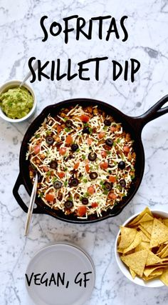 Tofu Sofritas Skillet Dip Recipe - This is a copycat of the vegan option at Chipotle that's been turned into a dip loaded with dairy free nacho cheese sauce, and topped with fresh veggies like tomatoes, green onions and olives. It's super flavorful and perfect for game day or as a vegetarian weeknight dinner.
