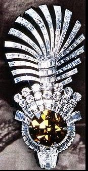 This breathtaking 61,50-carat whiskey-colored diamond, 'The Eye of the Tiger', was mounted by Cartier in a turban aigrette for the Maharajah of Nawanagar in 1934.